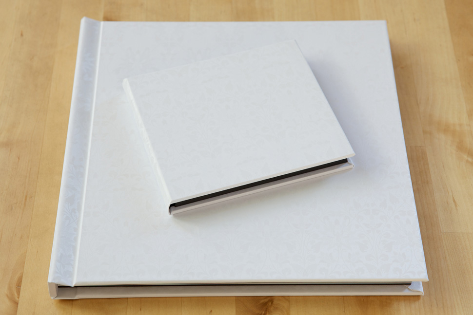 White press printed guest book with matching DVD case.