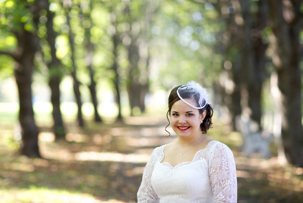 Bride wearing a homemade birdcage veil.