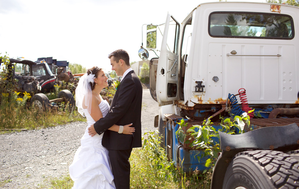 Wedding photo shoot in a scrap yard.