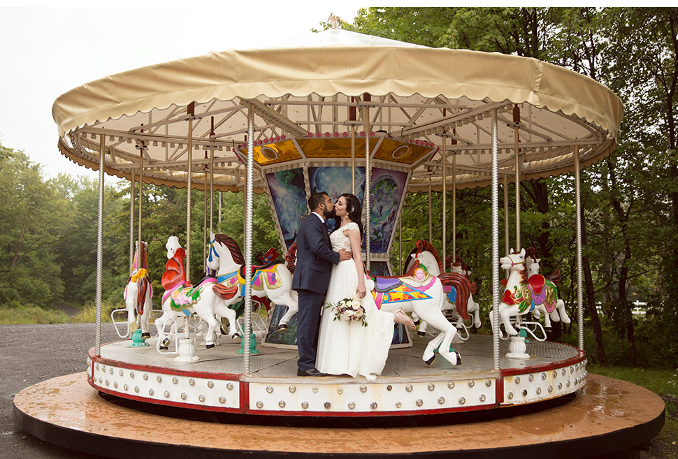 Bride and groom in amusement ride.